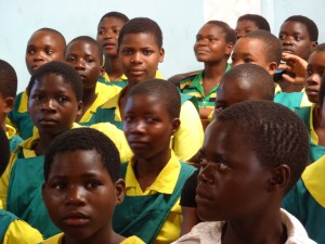 Girls in Nyezerera, Malawi, waiting patiently for their life packs