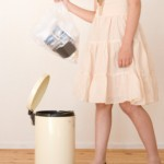 A girl throwing away