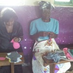 Women learning to sew pads in Malawi